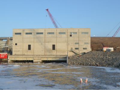 Downstream side of dam showing powerhouse and tailrace. March 2019