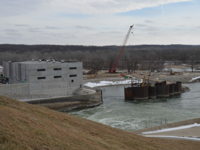 Downstream side of dam showing powerhouse and cofferdam removal. February 2019