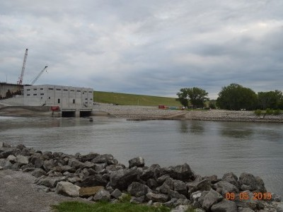 Downstream side of dam showing powerhouse with cofferdam removed. Sept. 5, 2019