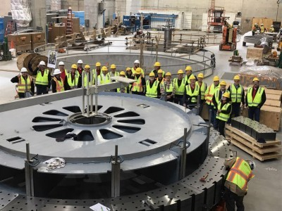 MRES and WMMPA Directors, city officials and policy makers from Pella (Iowa) stand around the generator rotor for Unit 1 during a tour of RRHP in October.