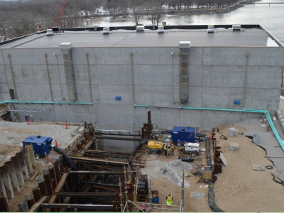 Downstream side of dam showing powerhouse and penstock for Unit 2 construction. February 2019